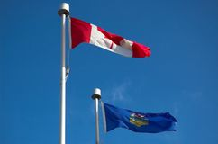 Alberta & Canada Flag. Flag of Alberta and Canada blowing in the wind stock photography