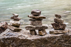 ALberta, Canada - Inukshuk rock piles by the lake. Inukshuk rock piles by the lake in ALberta, Canada Royalty Free Stock Photos