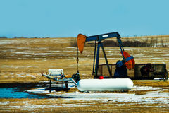 Alberta Oil Well. An oil well found in the Alberta Prairies Royalty Free Stock Photography