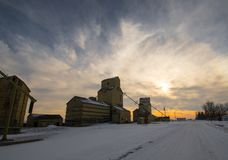 Alberta Prairie Sunset in Winter/ Grain Elevators Royalty Free Stock Images