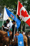 Albertan and Canadian flags flown during a parade Royalty Free Stock Images