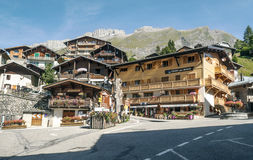 Albertville. Is a village in the French Alps, mountain backdrop looks. It is an editorial image on a sunny day. You can see a restaurant and the houses of the Royalty Free Stock Images