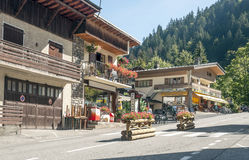 Albertville. Is a village in the French Alps, mountain backdrop looks. It is an editorial image on a sunny day. You can see a restaurant and the houses of the Royalty Free Stock Photography