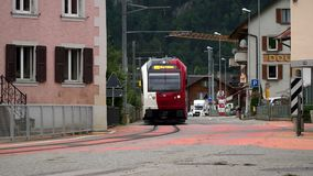 Albeuve, Switzerland - SEP 6, 2017: The train departs from Albeuve station. It is a small town in the Gruyeres district. Canton of Friborg, Switzerland. Summer stock video