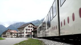 Albeuve, Switzerland - SEP 6, 2017: The train departs from Albeuve station. It is a small town in the Gruyeres district. Canton of Friborg, Switzerland. Summer stock video footage