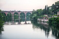 Albi, bridge over the Tarn river. Albi (Tarn, Midi-Pyrenees, France) - Panoramic view from the ancient bridge over the Tarn river at evening Royalty Free Stock Photos