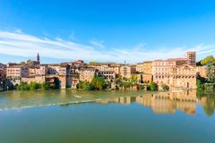 Albi in Southwestern France. Albi is a world heritage UNESCO site. View of the Tarn River and the Cathedral Saint Cecile. France Royalty Free Stock Images