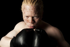 Albino Boxer. An albino African-American boxer on black background royalty free stock photo