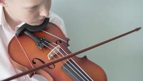 Albino boy plays the violin.  stock video