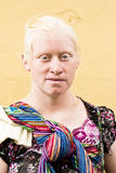 Albino mayan woman. A portrait of a traditionally dressed albino Mayan woman taken on the street while she was selling her crafts. September 16, 2013 in Antigua Royalty Free Stock Photo