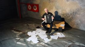 A albino musician with an accordion and notes. A albino musician play on accordion paper with notes falling to the floor stock video footage