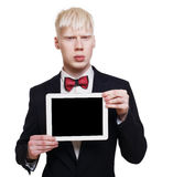 Albino young man in suit with laptop isolated. Albino young man portrait with tablet. Blond pale guy in suit with red bow tie isolated at white background stock photo