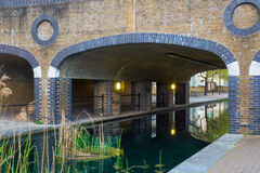 Albion Channel, London. Albion Channel under a path bridge, an ornamental canal created linking Canada Water to Surrey Water royalty free stock photo