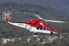 Ambulance Service of New South Wales AgustaWestland AW-139 VH-SYJ Air Ambulance Helicopter. Albion Park, Australia - May 4, 2014: Ambulance Service of New South royalty free stock photos
