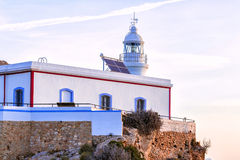 Albir lighthouse beautifully located on top of a cliff Stock Photo
