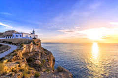 Albir lighthouse beautifully located on top of a cliff Stock Images