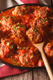 Albondigas meatballs with spicy sauce on a dish close-up. vertic Royalty Free Stock Images