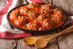 Albondigas meatballs with tomato sauce on a plate close-up. hori Stock Images