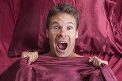 Albtraum im Bett Stockbild