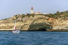 ALBUFEIRA, ALGARVE, PORTUGAL, AUGUST 14, 2017. A sailboat sails Royalty Free Stock Photo