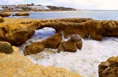 Albufeira Auramar beach rock erosion. Rock erosion from the sea on Auramar beach in Albufeira stock photography
