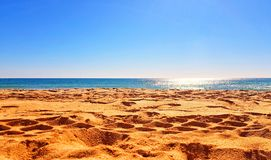 Albufeira Alemaes beach in Portugal, the sea shot across the sand royalty free stock image
