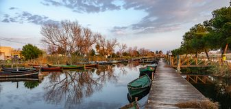 Albufera nature reserve with wooden fishing boats and pier at dusk Stock Image