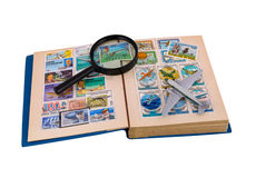 Album of aviation stamps, aircraft & magnifier Royalty Free Stock Photography