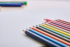 Album and crayons stock images