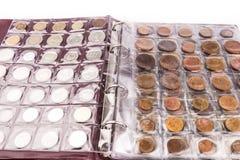 Album de pièce de monnaie avec des pièces de monnaie Images stock