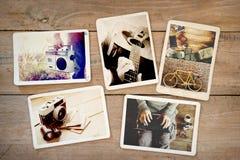 Album di foto del viaggio di viaggio di stile di vita dei pantaloni a vita bassa di estate sulla tavola di legno Fotografie Stock