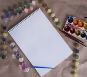 Drawing album with color paints on the table royalty free stock photos