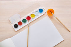 Album and paints Stock Photos