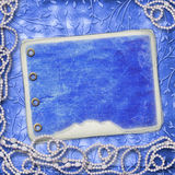 Album for photo with beads. On the leafage ornamental background Royalty Free Stock Photo
