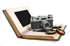 Album photos et appareil-photo Photographie stock libre de droits