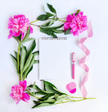 Album and pink flowers Royalty Free Stock Image