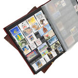 Album of postage stamps stock images