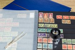 Album with postage stamps. Philatelic collection with postage stamps Stock Photos