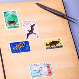An album of postage stamps. On the theme & x22; Former British colonies& x22 Royalty Free Stock Photo