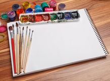 Album for sketches, watercolor paints and brushes Royalty Free Stock Photo