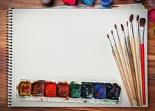 Album for sketches, watercolor paints and brushes Stock Images