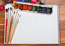 Album for sketches, watercolor paints and brushes Royalty Free Stock Photography