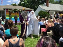 Albus and Gandalf Dumbledore-White. Topeka, KS - June 7, 2015: Symbolic wedding between two fictitious wizards at the Equality House in Topeka, KS (across the Royalty Free Stock Image