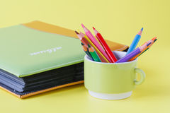 Albums for pictures and pen in mug Royalty Free Stock Photo