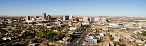 Albuquerque Downtown City Metro Skyline Desert South New Mexico. Early morning with empty streets in downtown Albuquerque buildings roads and businesses Stock Photos