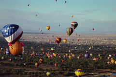 Albuquerque Hot Air Balloon Festival. View from inside a hot air balloon watching as other balloons take off into the Albuquerque sky at sunrise. (Image taken stock photography