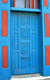Albuquerque Painted Door. Building in Old Town Albuquerque, New Mexico, catches the eye. It's two tone turquoise and burgundy painted woodwork is vivid and royalty free stock photography
