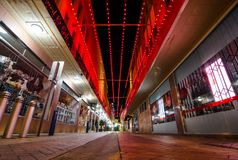 Brightly-coloured red lights alleyway paths decoration at Albury CBD. stock image