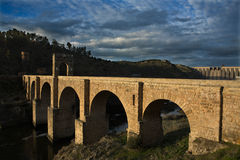 The Alcántara Bridge. (also known as Puente Trajan at Alcantara) is a Roman stone arch bridge built over the Tagus River at Alcántara, Spain between 104 and Stock Photography