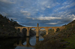 The Alcántara Bridge 2. The Alcántara Bridge (also known as Puente Trajan at Alcantara) is a Roman stone arch bridge built over the Tagus River at Alcántara Stock Image